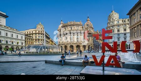 'Genova' sign at Piazza De Ferrari in the heart of Genoa, a City square known for its 1930s bronze fountain and prominent buildings and inastitutions, - Stock Photo