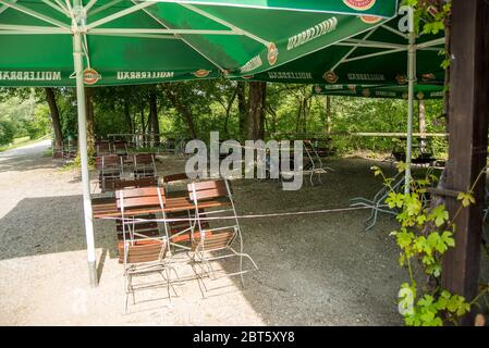 Perach,Germany-May 22,2020: View of a cordoned off Biergarten with tables  set to comply with the new rules for restaurants in Bavaria. - Stock Photo