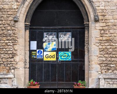 Willingham Cambridgeshire, UK. 23rd May, 2020. The church remains closed with signs on the shut door announcing that the church is closed but God is always open due to the coronavirus or covid-19 pandemic. President Trump has called for churches in USA to be reopened and they remain closed in the UK. Credit: Julian Eales/Alamy Live News