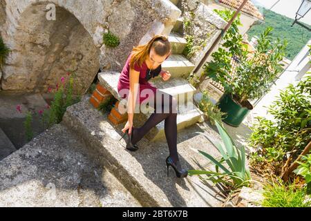 Teengirl fanciful detaching detach high-heeled Black pumps stiletto shoes painful heel - Stock Photo