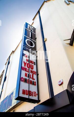 22 May 2020 London, UK - Sign on the facade of Rio Cinema, Dalston, Hackney saying 'Dear Virus You Will Not Kill Cinemas, Mubi' during the Coronavirus pandemic lockdown - Stock Photo