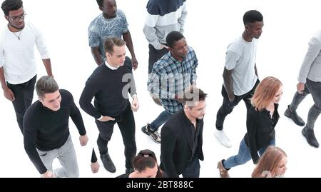 group of diverse young people walking together - Stock Photo