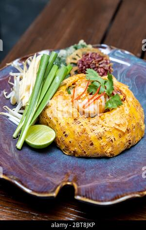 Padthai, Thai style pan fried rice noodle with tamarind sauce, serve with grilled tiger prawn cover with omelette.Thai gourmet cuisine recipe Restaura - Stock Photo