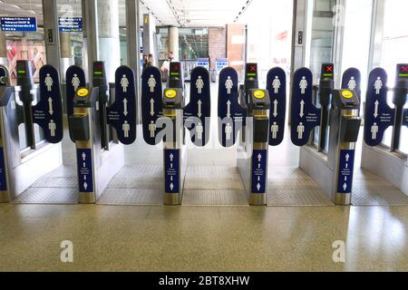 London, UK. 23rd May, 2020. Day Sixty One of Lockdown, in London. Ticket barriers at St. Pancras station, with social distancing advice on them. Even though there has been a partial lifting of lockdown, there are still many shops that have to remain closed, including barbers and hairdresser salons, but more people seem to be out and about on the streets and in the countryside. COVID-19 Coronavirus lockdown, London, UK, on May 23, 2020 Credit: Paul Marriott/Alamy Live News - Stock Photo