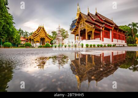 Wat Phra Singh in Chiang Mai, Thailand at dusk.