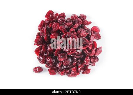 A handful of dried cranberry berries isolated on white. View from above