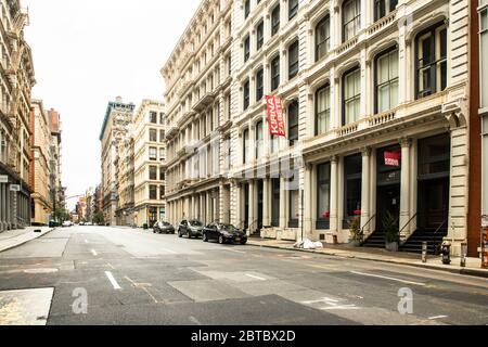 New York City, New York, USA - May 24, 2020:  Quiet street in SoHo in Manhattan during the Covid-19 Coronavirus Pandemic