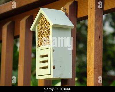 Bee and pollinator house. Provides nesting cavities for solitary bees and hiding place for polllinators. - Stock Photo