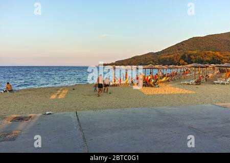 STAVROS, GREECE - AUGUST 19, 2019:  Sunset at coastline of village of Stavros, Chalkidiki, Central Macedonia, Greece - Stock Photo