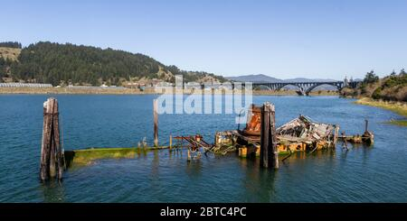 A steamer build in 1881 in Gold Beach now resting in peace in the Rouge River where it sank in 1985 now an important piece of culture and history and - Stock Photo