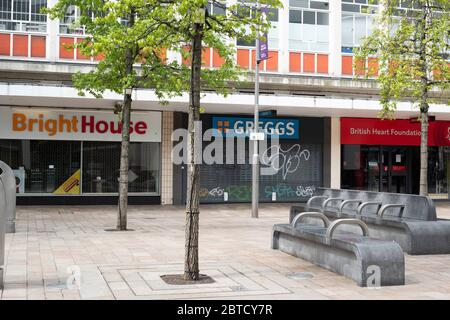 Sheffield UK –  April 30 2020: a closed retail outlet, food take out and charity shop - non-essential businesses cease trading in Sheffield during the - Stock Photo