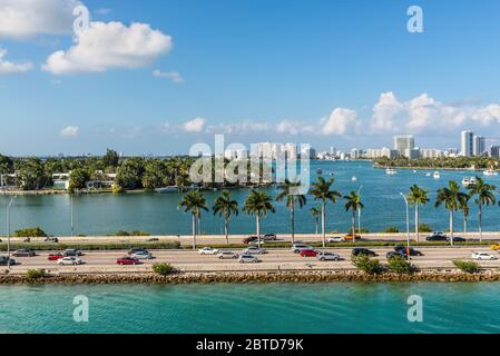 Miami, FL, United States - April 28, 2019: Causeway from downtown to Miami beach, Biscayne Bay and Star, Palm and Hibiscus Islands in Miami, Florida,