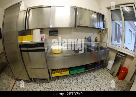 large interior of the industrial kitchen with large stainless steel sinks and without the cooks - Stock Photo