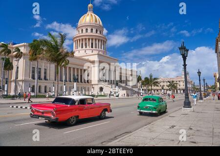 National Capitol Building and old American red Car, Havana, Cuba