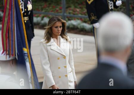 First lady Melania Trump accompanied by United States President Donald J. Trump and US Vice President Mike Pence commemorates Memorial Day by participating in a Wreath Laying ceremony at Arlington National Cemetery in Arlington, Virginia on Monday, May 25, 2020.Credit: Chris Kleponis/Pool via CNP /MediaPunch - Stock Photo