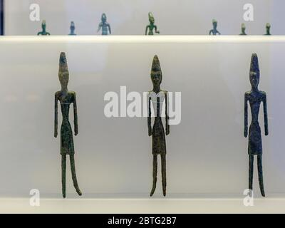 male statuettes, from Byblos, bronze, middle bronze Age, Beirut National Museum, The Coliseum , Rome, Lazio, Italy ,. - Stock Photo
