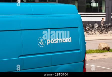 Blue van with Postnord logotype. PostNord AB is the name of the holding company of the two merged postal companies Posten AB Sweden and Post Danmark. - Stock Photo