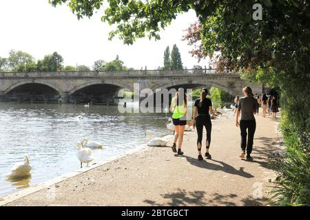 Walking by the side of the Serpentine, on a hot Bank Holiday Monday, May 25th 2020, as coronavirus restsrictions are eased, in west London, UK - Stock Photo
