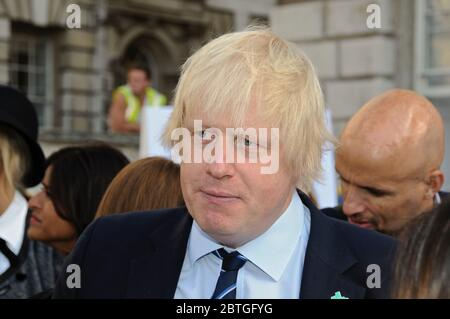 Boris Johnson current Prime Minister was London Major and the Foreign secretary before he use to enjoy cycling around London and rubbing shoulders with those in the Fashion industry . - Stock Photo