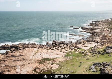 Aerial view of the coast of Cabo Polonio. South American fur seals, Arctocephalus australis, and South American sea lions, Otaria flavescens, on a roc - Stock Photo