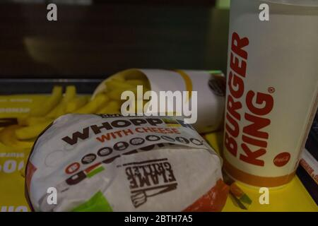 'RAK, RAK/UAE - 2/14/2020: Burger King Whopper Meal on a tray a high calorie meal leading to American and global obesity and public health problems' - Stock Photo