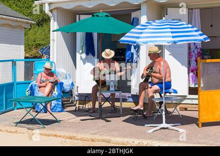 Bournemouth, Dorset UK. 26th May 2020. UK weather: another hot sunny day at Bournemouth beaches with clear blue skies and unbroken sunshine, as the glorious weather continues and temperatures rise. Sunseekers head to the seaside to enjoy the sunshine. Time for some music. Credit: Carolyn Jenkins/Alamy Live News - Stock Photo