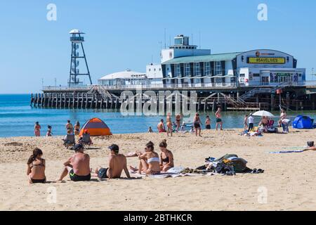 Bournemouth, Dorset UK. 26th May 2020. UK weather: another hot sunny day at Bournemouth beaches with clear blue skies and unbroken sunshine, as the glorious weather continues and temperatures rise. Sunseekers head to the seaside to enjoy the sunshine. Credit: Carolyn Jenkins/Alamy Live News - Stock Photo