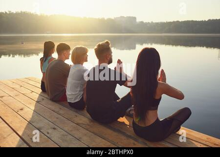 Group of people resting relax in the park by the lake - Stock Photo