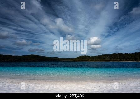 Crystal clear blue water of Lake McKenzie. - Stock Photo
