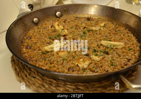 Paella is a Spanish rice dish originally from Valencia. Paella is one of the best-known dishes in Spanish cuisine. - Stock Photo