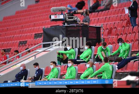 Leverkusen, Germany. 26th May, 2020. Football: Bundesliga, Bayer Leverkusen - VfL Wolfsburg, 28th matchday in the BayArena. Wolfsburg players watch the game from the stands. IMPORTANT NOTICE: In accordance with the regulations of the DFL Deutsche Fußball Liga and the DFB Deutscher Fußball-Bund, it is prohibited to use or have used in the stadium and/or photographs taken of the match in the form of sequence images and/or video-like photo series. Credit: Marius Becker/dpa-Pool/dpa/Alamy Live News Stock Photo