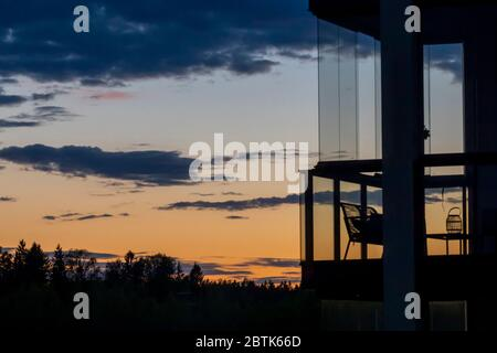 Finnish sunset and balcony silhouette with no people in Southern Finland - Stock Photo