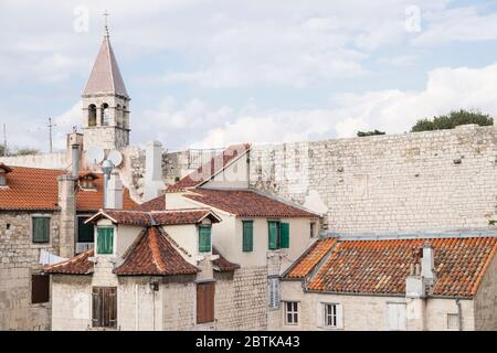 Looking over the red tiled rooftops of Split's historic Old Town towards the Bell Tower of St. Arnir Chapel, Split, Croaia