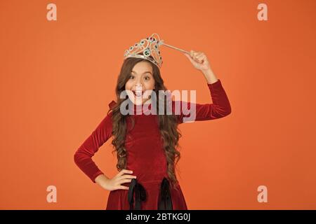Indulge yourself in Luxury. royal and luxury. happy girl long curly hair in crown. little princess hold magic wand. magic queen from fairytale. just make a wish. all dreams come true. airs and graces. - Stock Photo