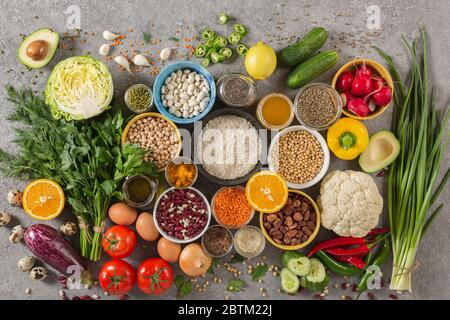 concept balanced diet of fruits, vegetables, seeds, legumes, grains, cereals, herbs and spices. Products containing vitamins, mineral salts, antioxida - Stock Photo