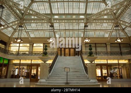 Horizontal frontal shot of the beautiful staircase of the Rookery Building lobby, remodeled by Frank Lloyd Wright in 1905, Chicago, Illinois, USA - Stock Photo