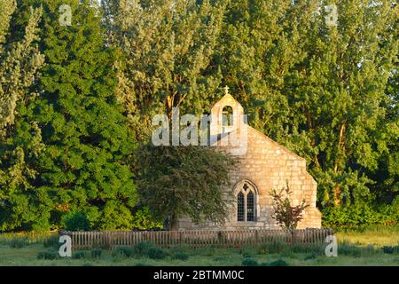 St Mary's Chapel at Lead, near Tadcaster, lies in the middle of a field as if abandoned, but  still provides regular church services - Stock Photo