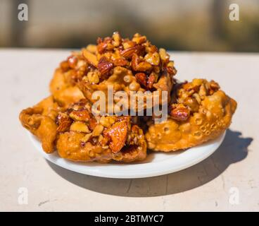 Cartellate Pugliesei italian traditional food from Puglia region named crispy puff pastry with honey and almond - Stock Photo