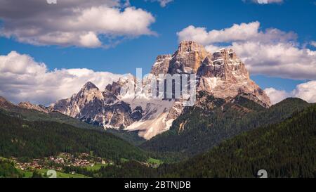 Scenic view of Pelmo Mountain (italian dolomites) against blue sky, with the town of Selva di Cadore in the Fiorentina Valley (Italy, Veneto region) Stock Photo