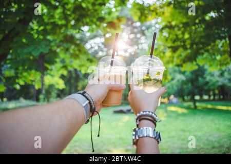 couple hands holding cup with cooling drink Stock Photo