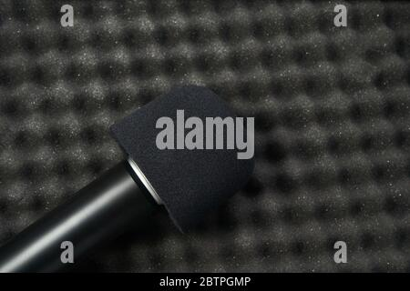 Podcast record at studio. Microphone at protection background. - Stock Photo