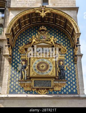 The clock on the Tour de l'Horloge of the Palais de la Cité in Paris, France - Stock Photo