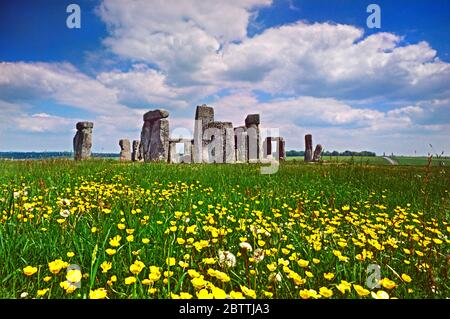 Stonehenge a prehistoric monument in Wiltshire, England with abundant spring flowers in foreground.One of the most famous landmarks in the United Kingdom, Stonehenge is regarded as a British cultural icon. On UNESCO's list of World Heritage Sites - Stock Photo