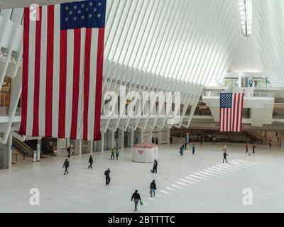 New York, New York, USA. 27th May, 2020. New York, New York, U.S.: two American flags are displayed inside the Oculus at the World Trade Center during the Coronavirus outbreak. Credit: Corine Sciboz/ZUMA Wire/Alamy Live News