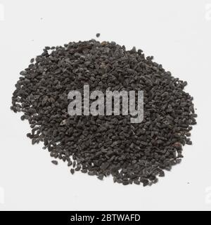 Close-up view of raw black cumin on white background.