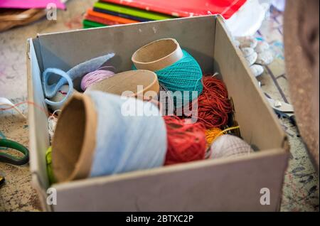 Different color balls of threads wool yarn isolated, lab in background. - Stock Photo