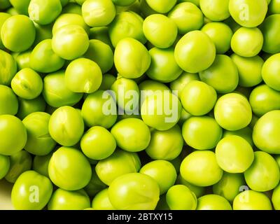Close up of freshly shelled garden peas - Stock Photo