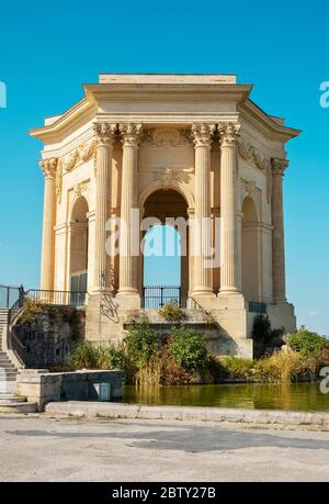 a view of the Promenade du Peyrou garden in Montpellier, France, highlighting the Chateau de eau, its iconic neoclassical water tower, presiding over - Stock Photo