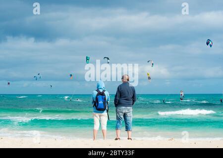 People watching the kite surfers, Flag Beach, Fuerteventura, Canary Islands, Spain, Atlantic, Europe - Stock Photo