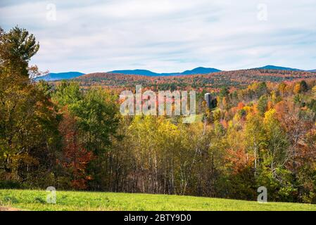 Beautiful rolling forested hills dotted with meadows on a sunny autumn day. Beautiful fall foliage.